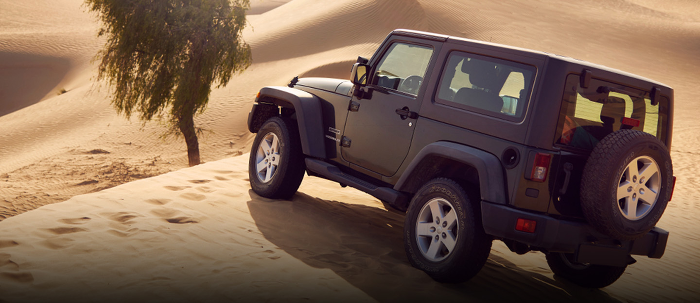 SUV in a desert for outdoor adventures in the UAE