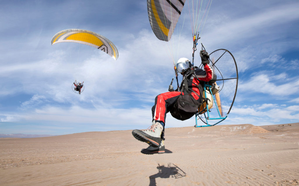 Pilot taking off with paramotor