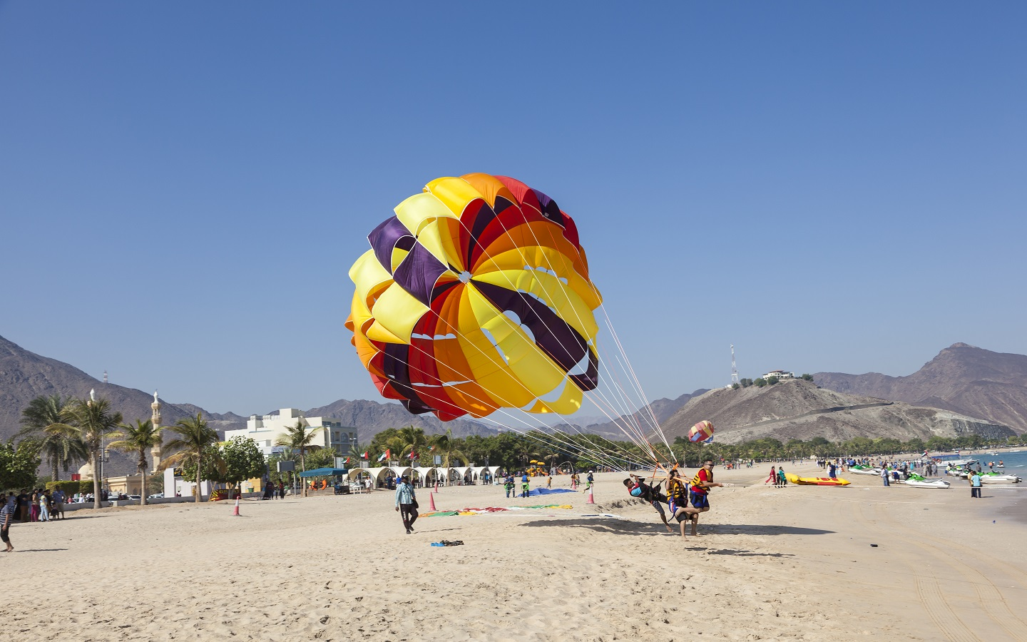 Tourist Parasailing at Khorfakkan Beach