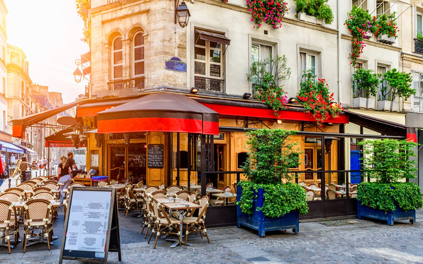 Cafe with outdoor seating on a street in Paris