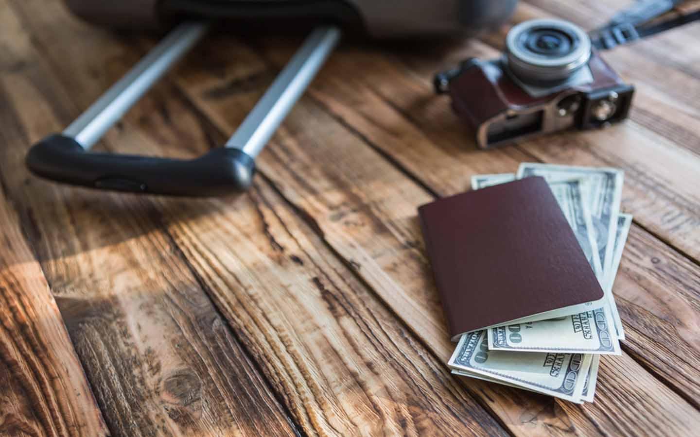 A passport, money, camera, & a travel bag