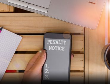 Person checking to pay traffic fine online in Abu Dhabi