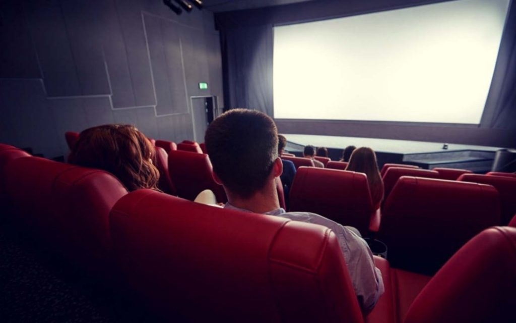 People at a cinema in Dubai, watching a blank screen