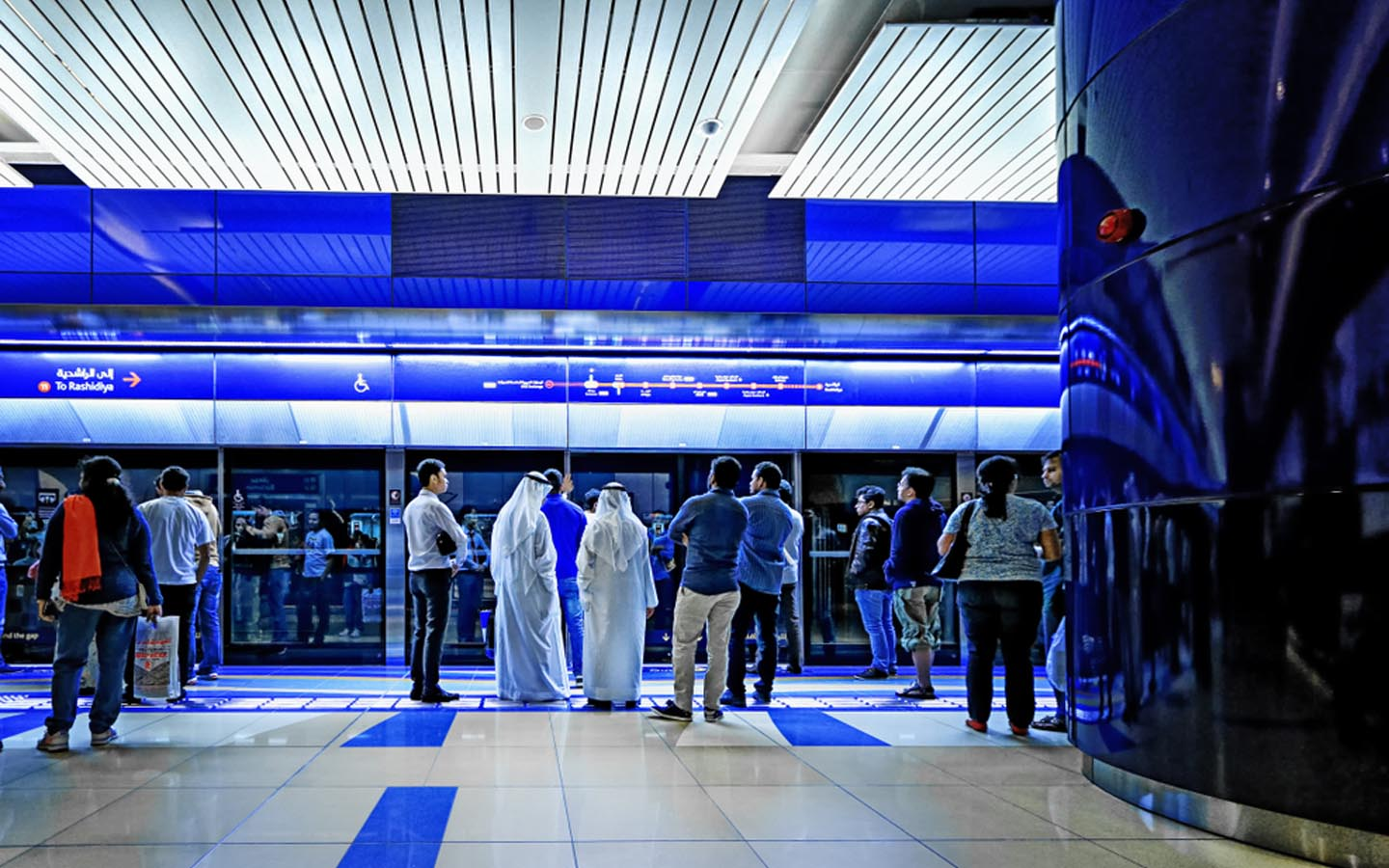 People waiting at a metro station in Dubai