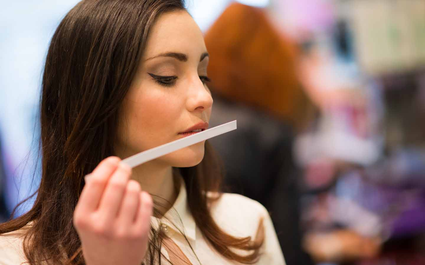 A lady testing scents at perfume shops in Dubai