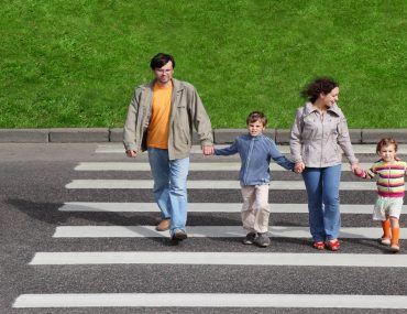 A family using a zebra crossing