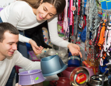 Couple looking for supplies at pet shops in Dubai