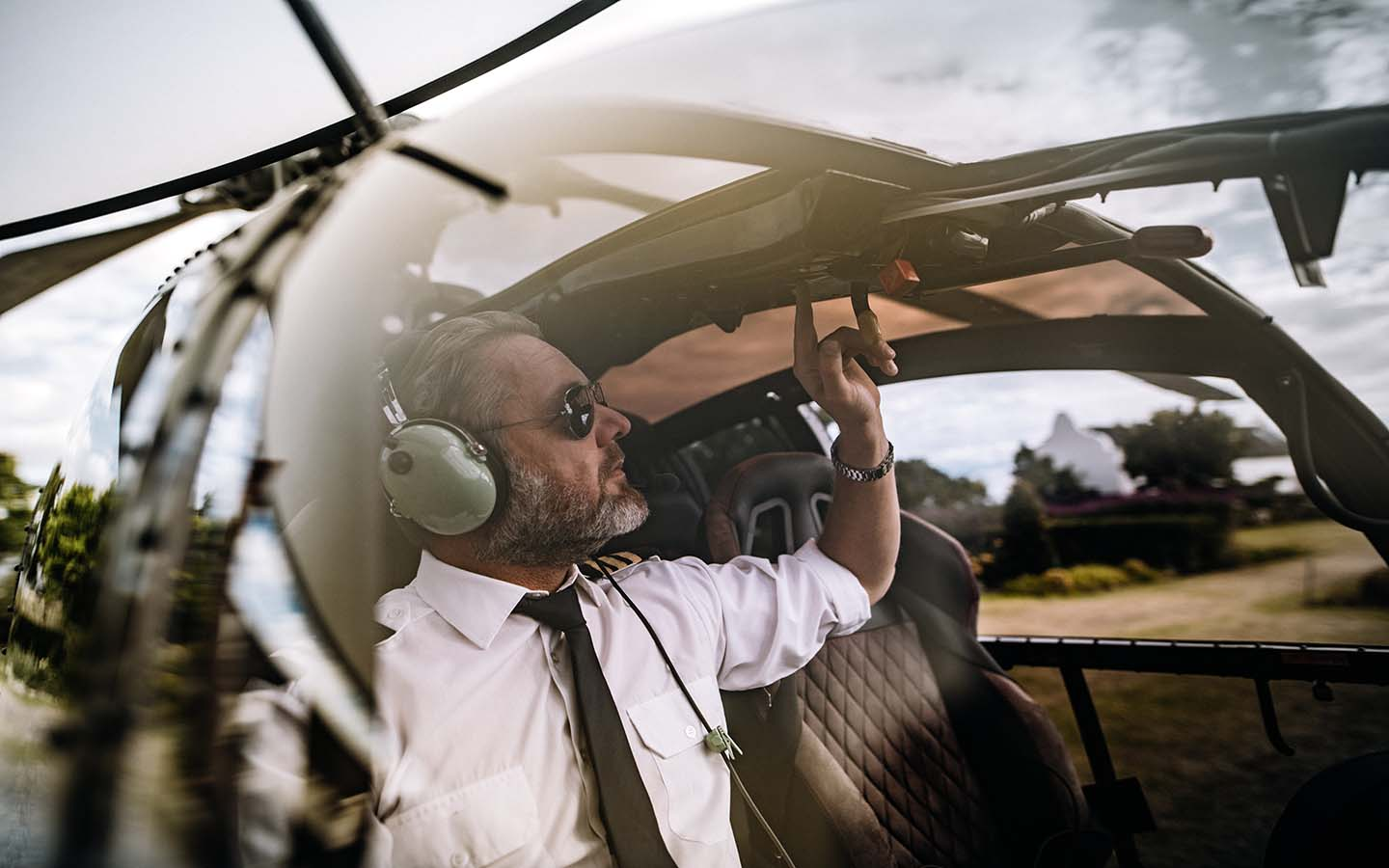 A pilot readies a helicopter for Atlantis Helicopter tours