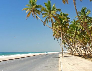 car driving along seashore in Salalah