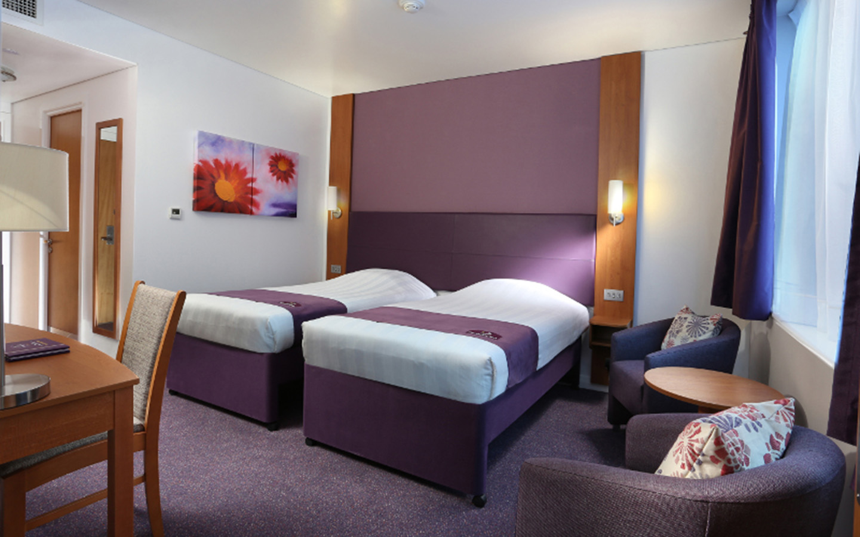 Inside of a bedroom at Premier Inn Abu Dhabi