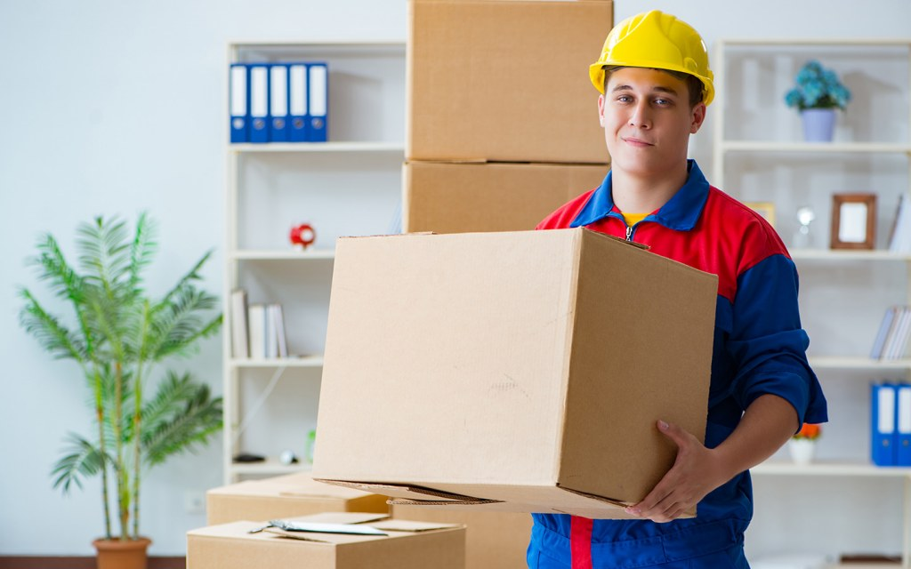 Man holding a box, offering house moving services in Dubai