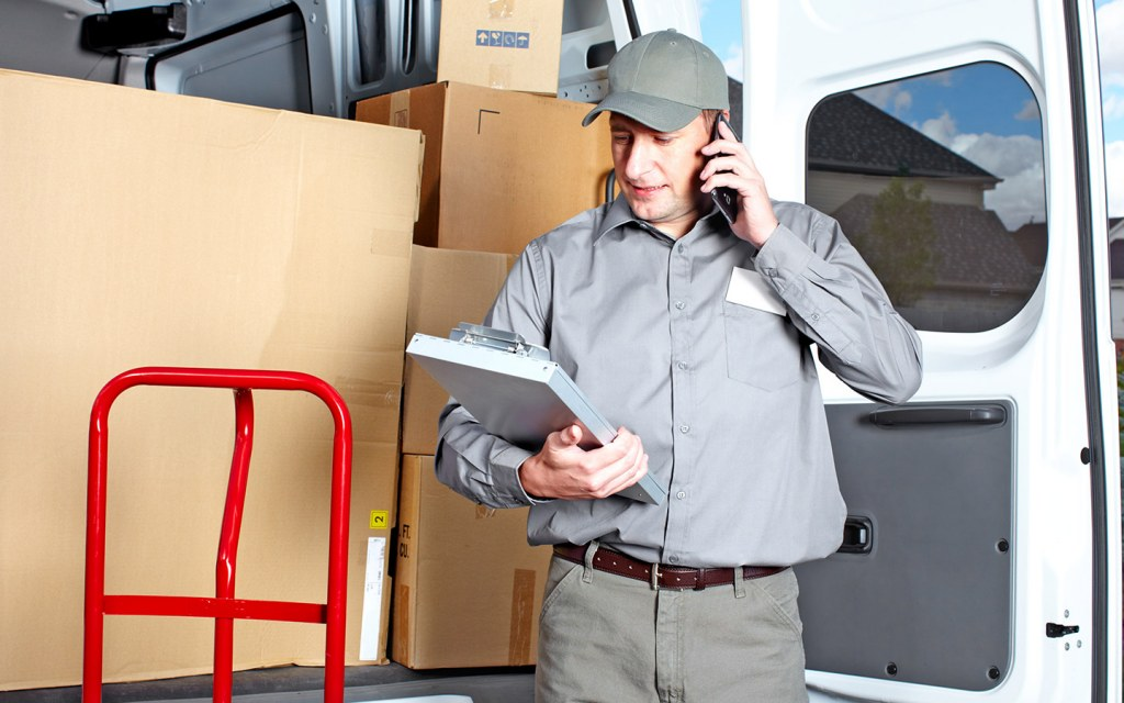 Handyman from movers and packers in Dubai unloading boxes