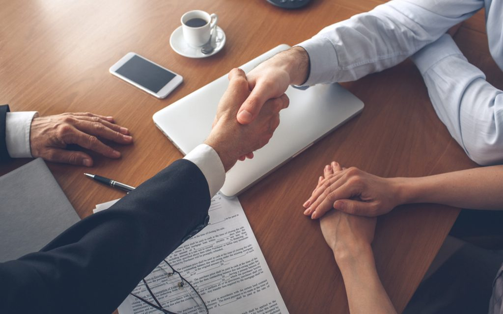 Real estate agent shaking hands with a customer