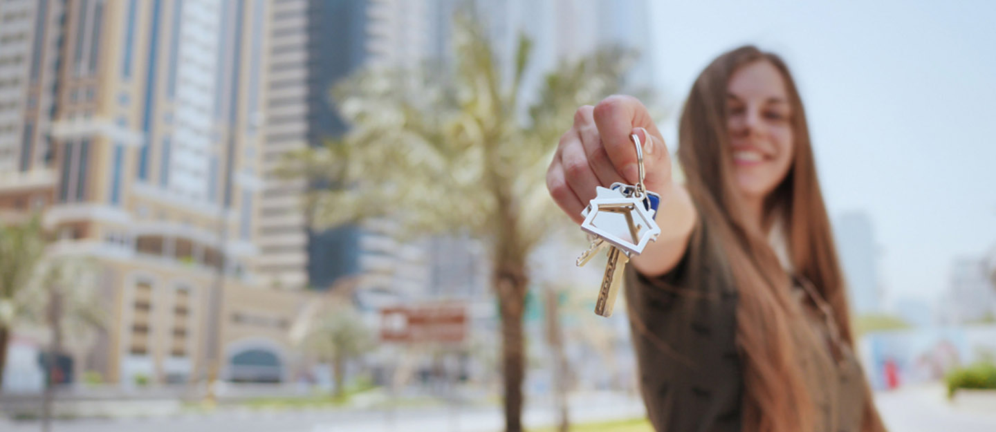 Woman with keys to a home in Dubai