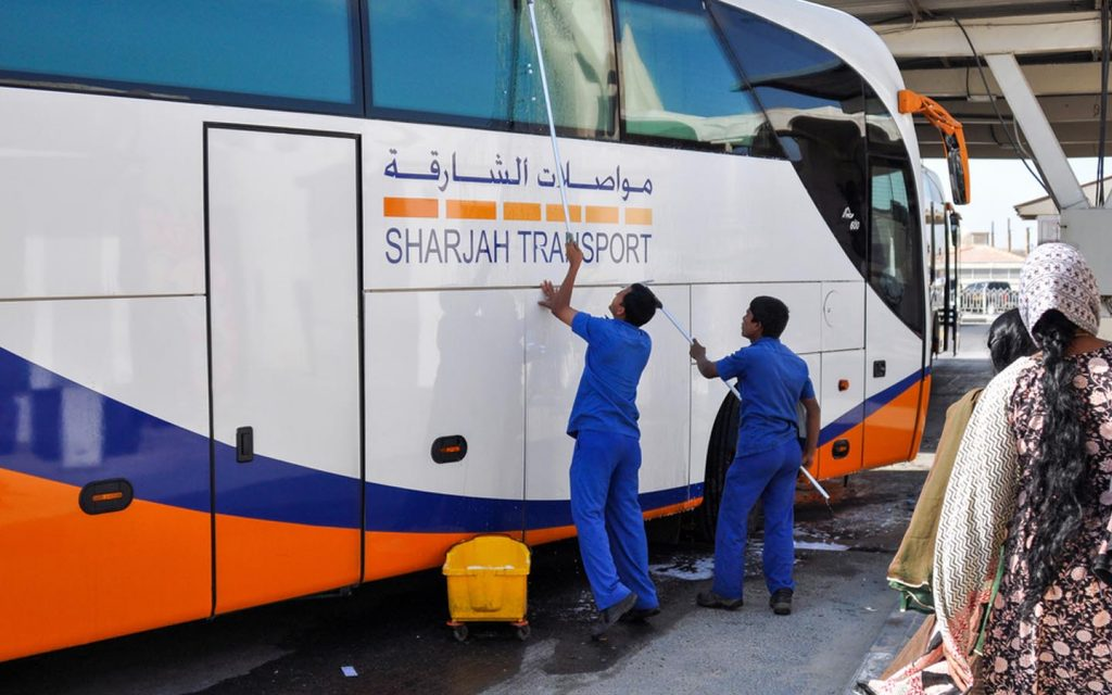 Workers cleaning up a public bus in Sharjah