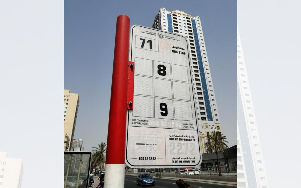 Mowasalt bus stop in Sharjah displaying bus number and route number