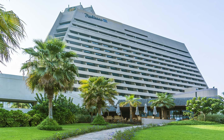 A landscape view of Raddison Blu Hotel building in sharjah