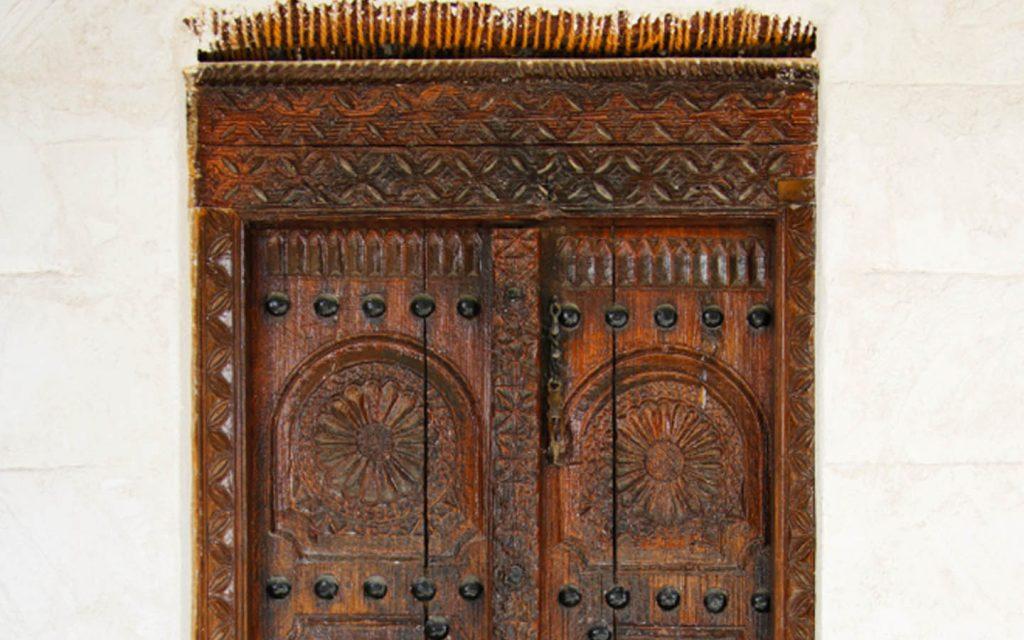 Wooden doors in RAK Museum display a beautiful carving