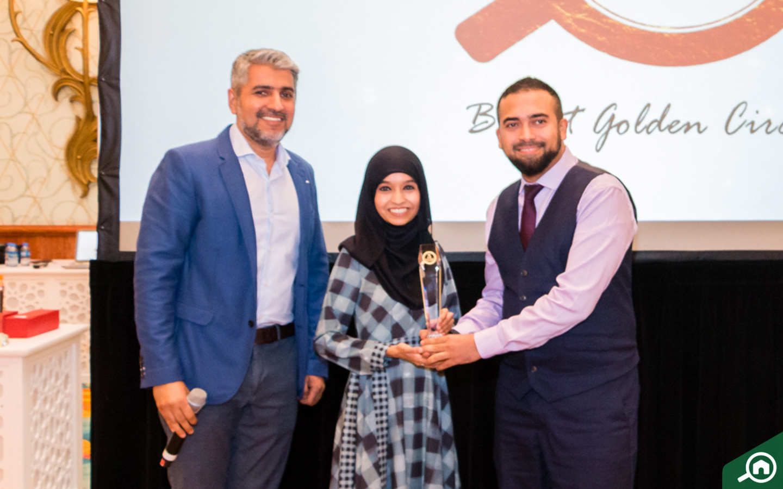 Real Returns Group receiving the Golden Circle award at the Bayut Iftar