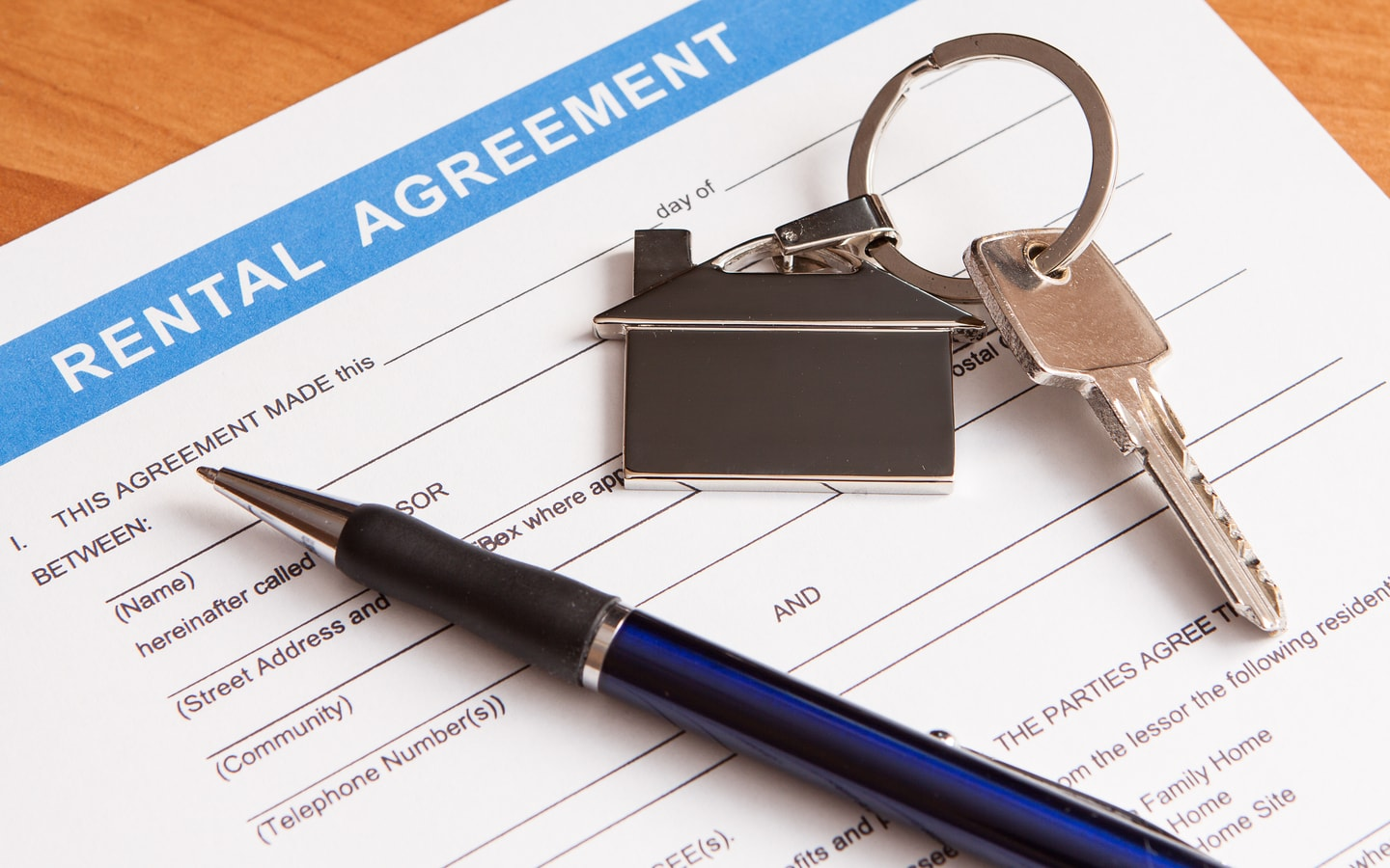 rental contract with pen and house keys
