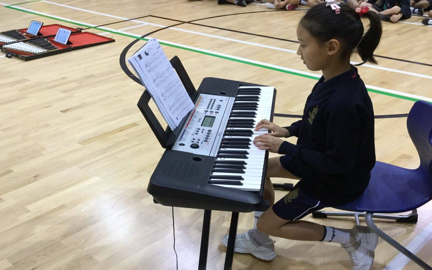 A girl playing piano at Repton School