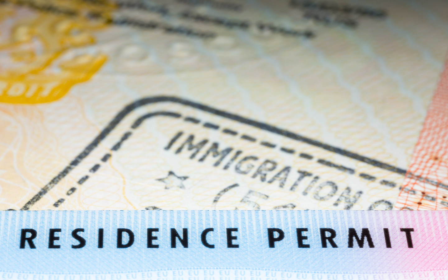 View of immigration stamp and residence permit on passport