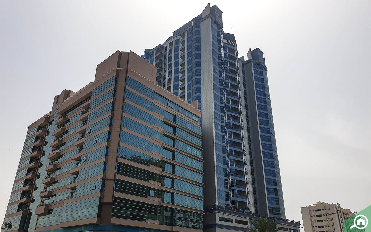 Residential building in Al Bustan, one of the best residential areas in Ajman for families