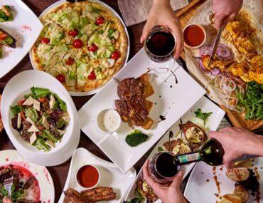 People enjoying food at restaurants in Al Garhoud Dubai