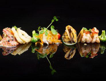 fine dining seafood on black background