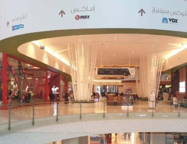 Yas Mall with people eating nearby