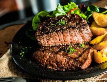 steak dinner with fries