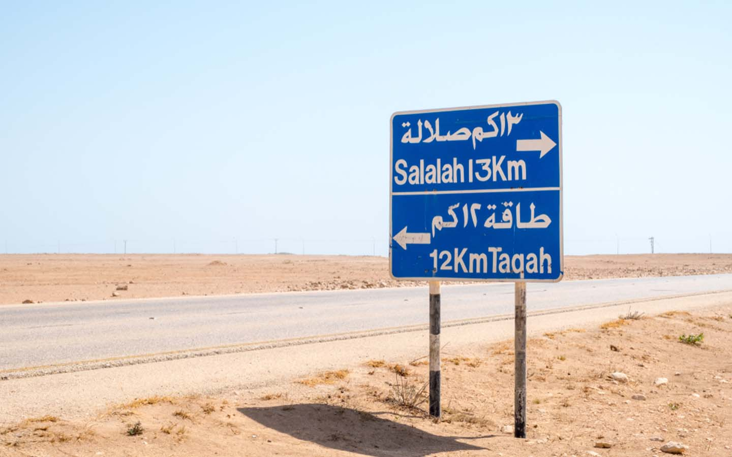 road sign with directions to Salalah in Oman