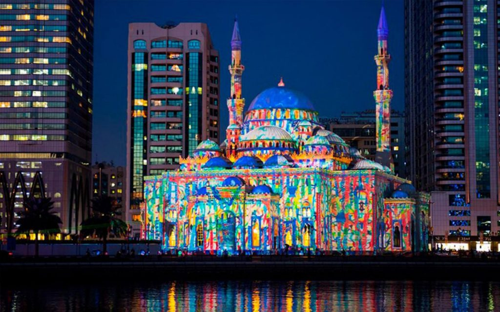 The facade of the Al Noor Mosque is lit up during the Sharjah Light Festival