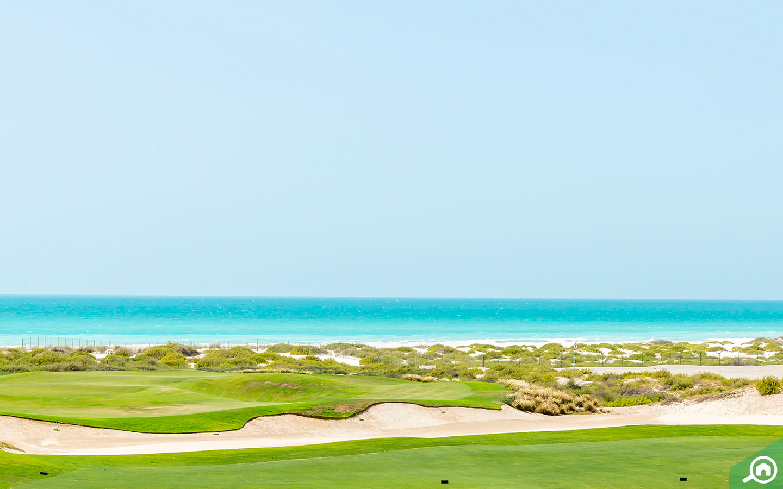 View of golf course and beach at Saadiyat Island