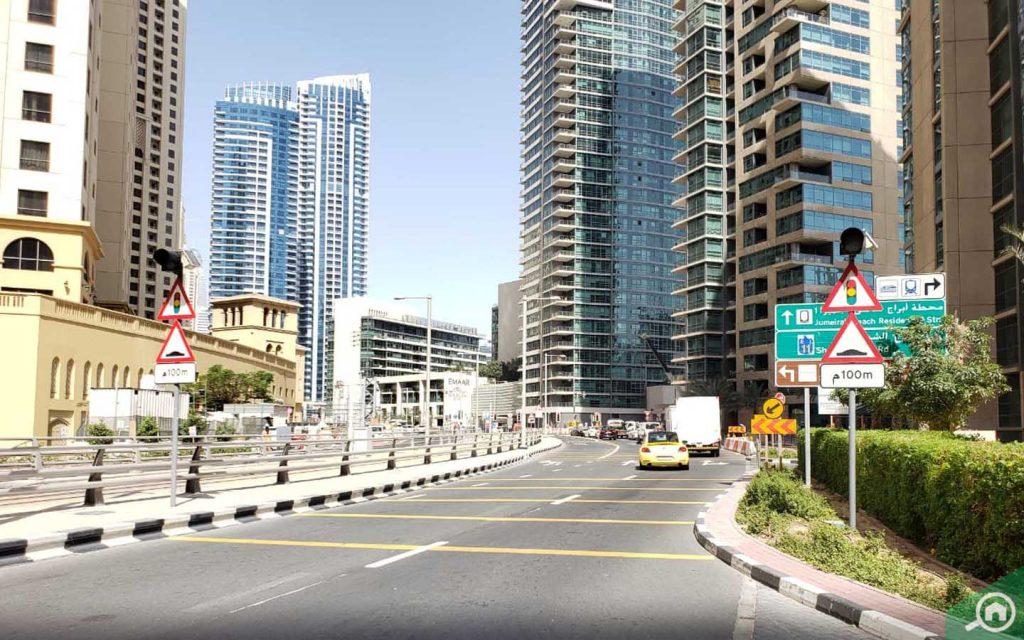 View of Tram tracks and buildings in Dubai Marina