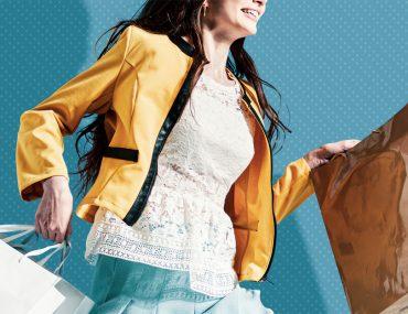 woman rushing with shopping bags