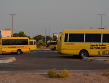 A small fleet of busses of one of the school transport companies in Abu Dhabi