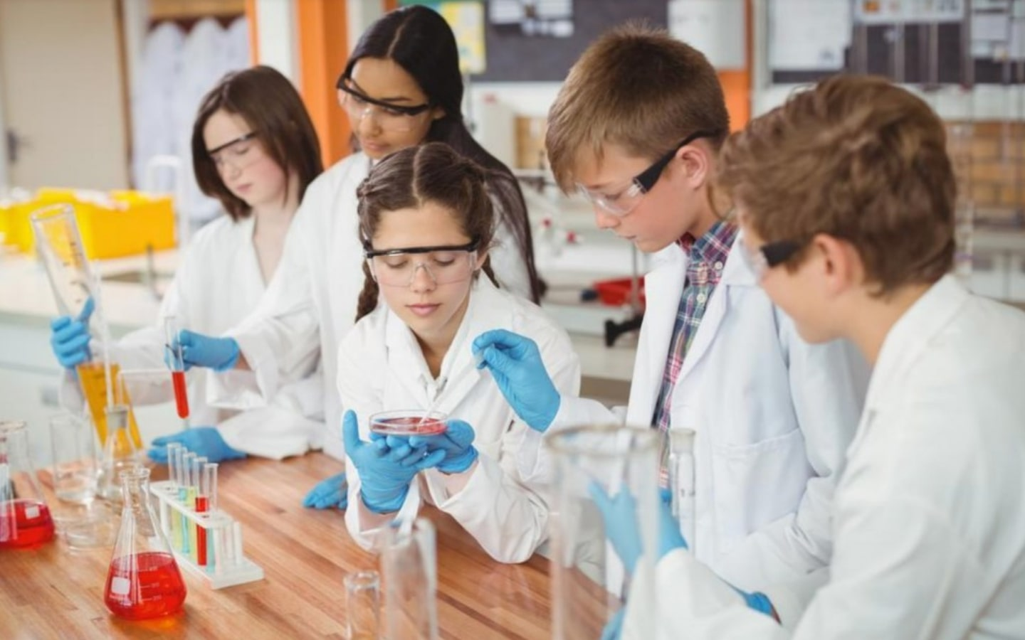Students doing a chemical experiment in schools in Abu Dhabi