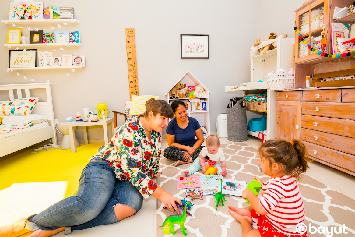 Helen and her girls playing in their room