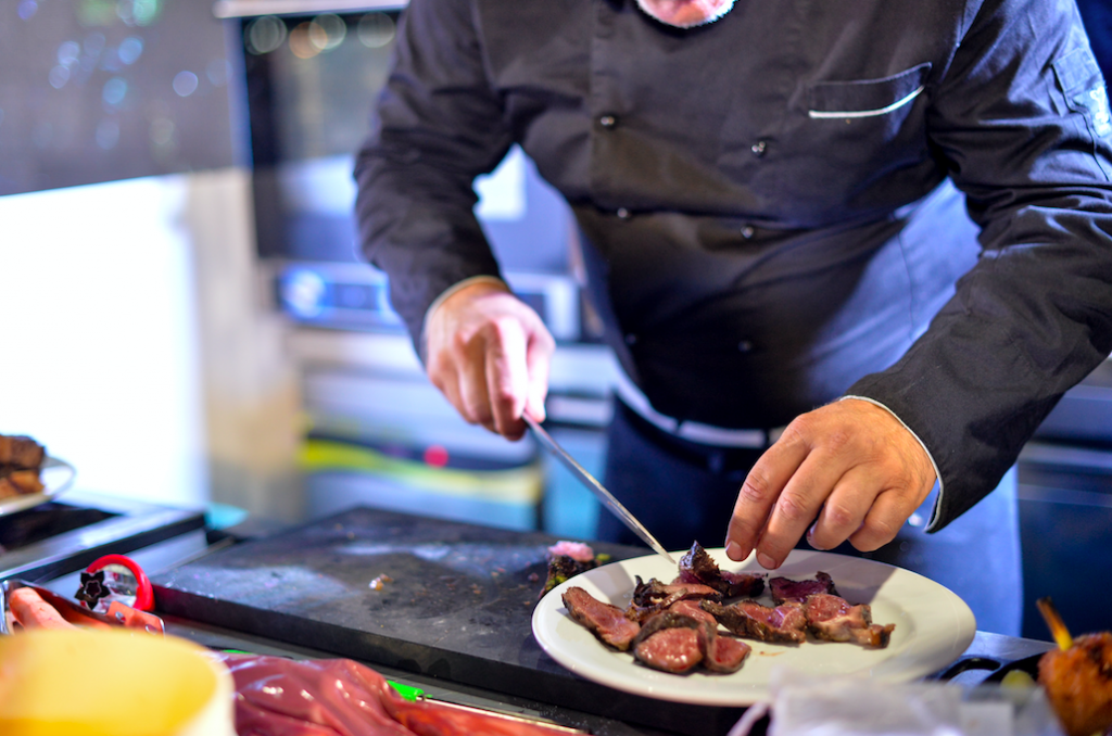a professional chef cooking meat