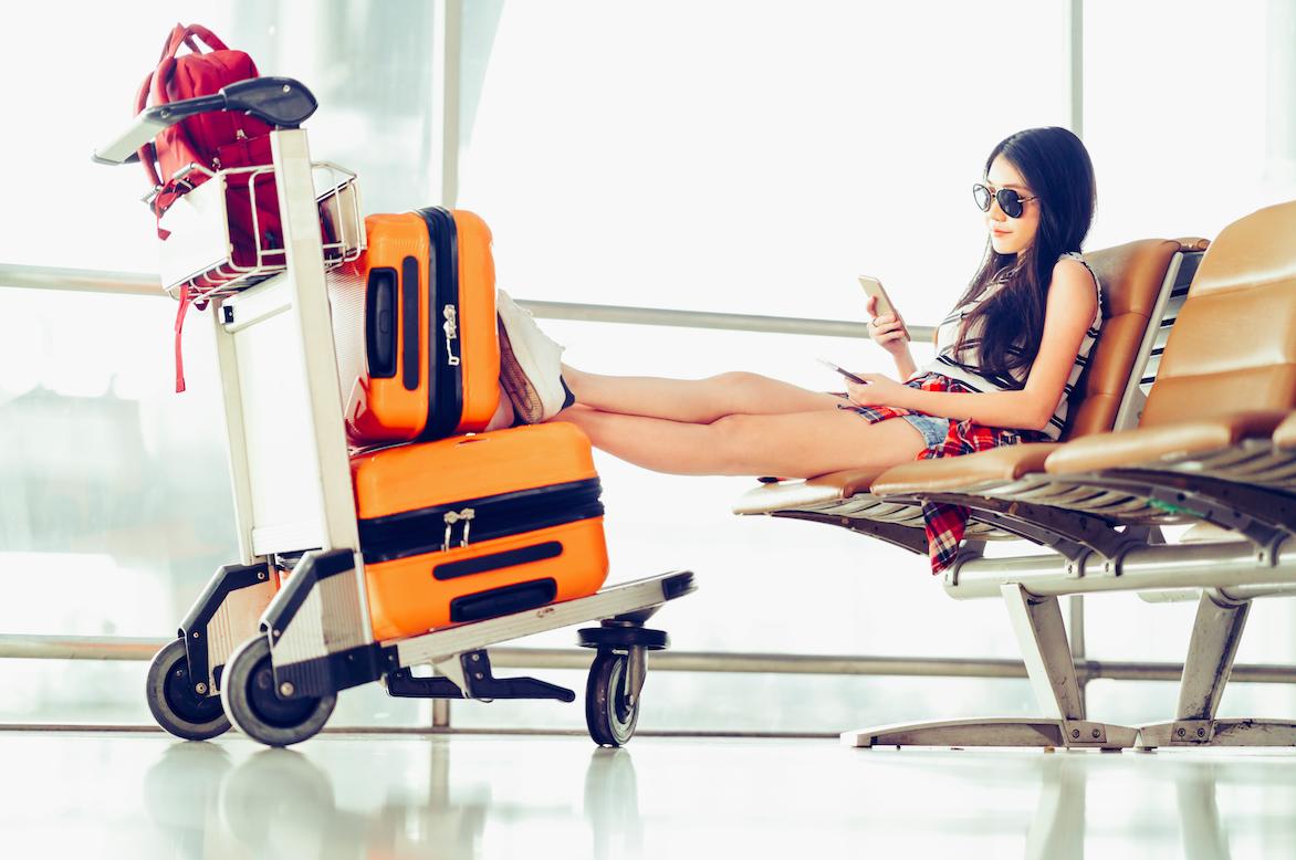 Student waiting at an airport