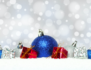Christmas Decoration Ideas Blog Cover: Blue, red and silver Christmas ornaments against on crisp white snow against a sparkly gray background