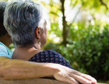 senior couple on a park bench