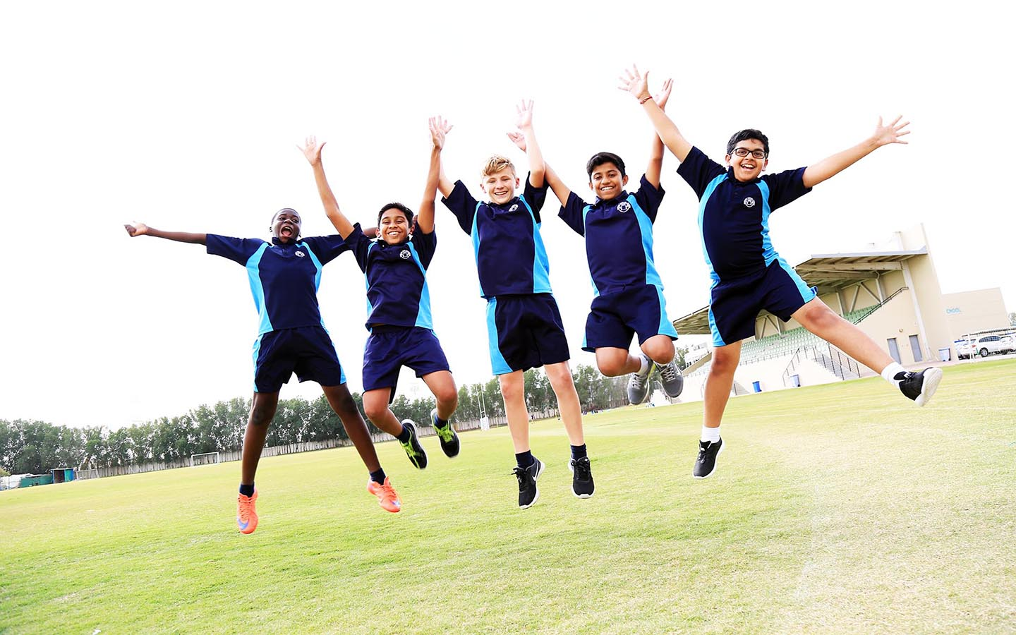 School kids group jumping and posing for photo