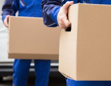 A Shipping team transferring things in boxes during international transfer