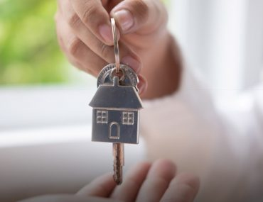 person handing to key for short-term rental property in Dubai