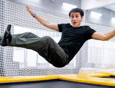 Boy on a trampoline court