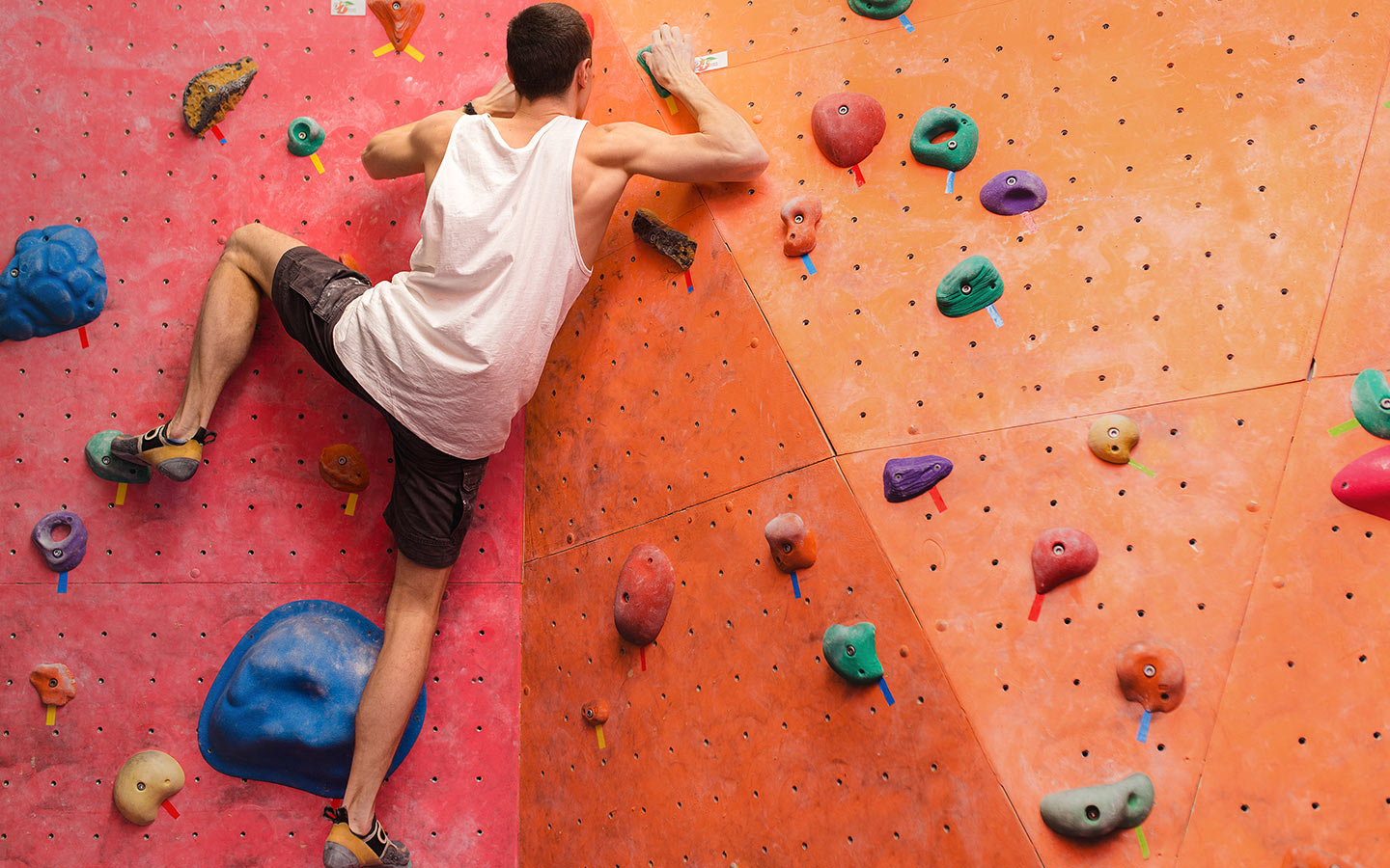 View of person on a rock climbing wall