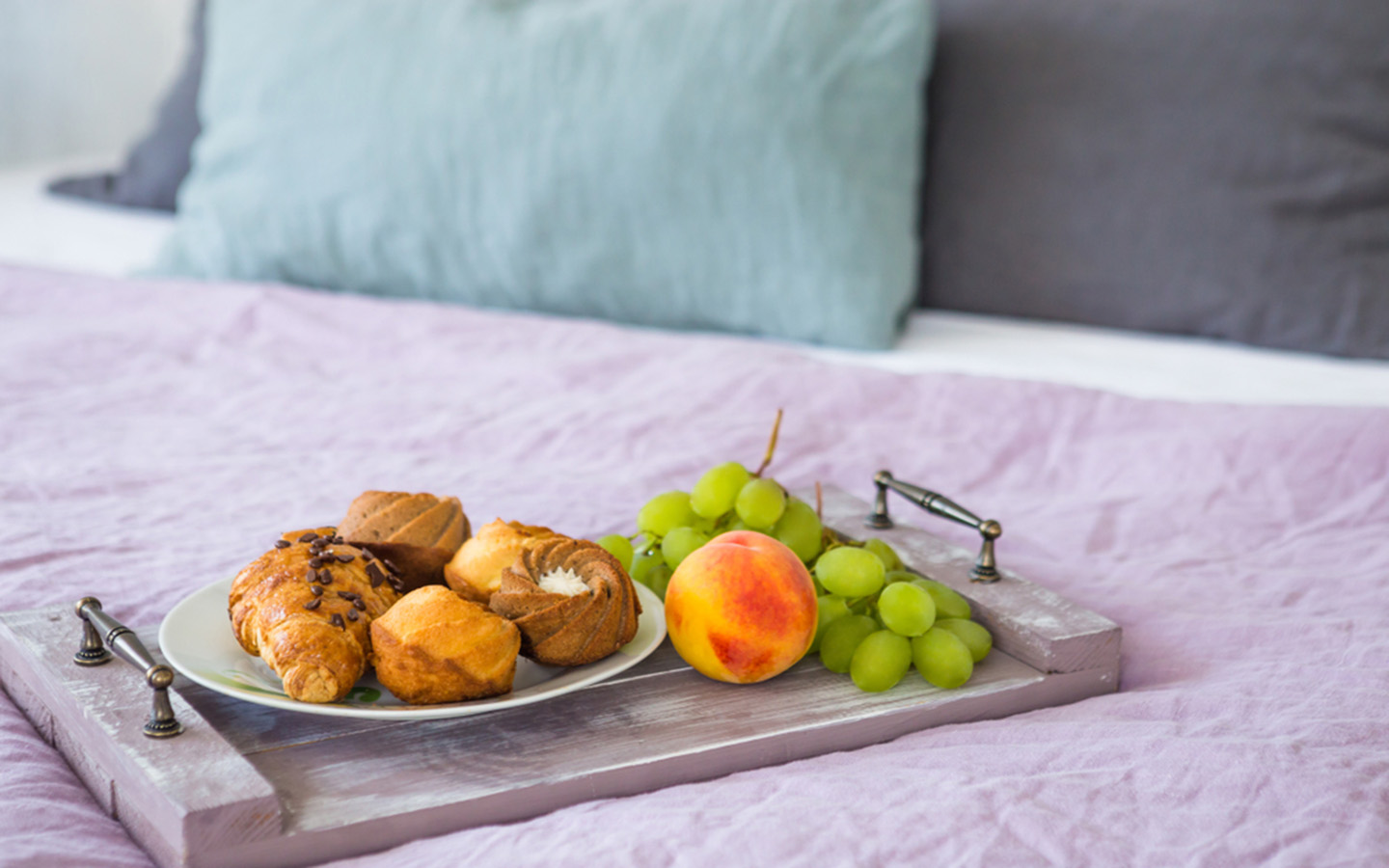 Close-up shot of a healthy breakfast lying on the bed at Skybridge hotel Abu Dhabi