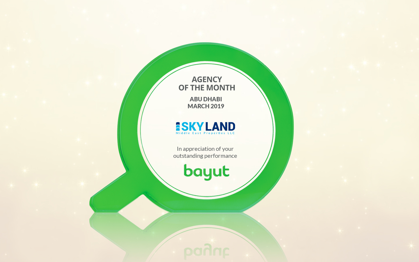 Image of a trophy with Sky Land Properties logo